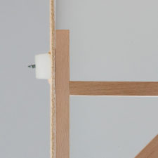 View of cross section of GeeFix with shelf bracket fixed onto hardboard